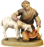 Kneeling shepherd with sheep