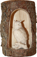 Owl on branch in cave