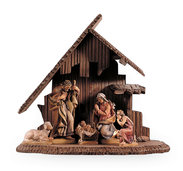 Holy Family with child, sheep and stable