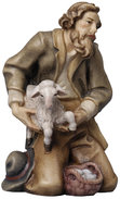 Shepherd kneeling with sheep